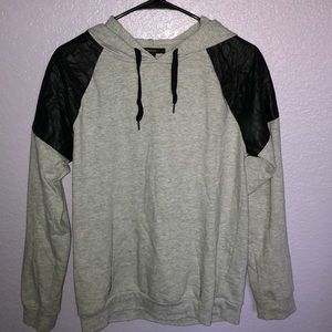 Grey hoodie with faux leather shoulder patch